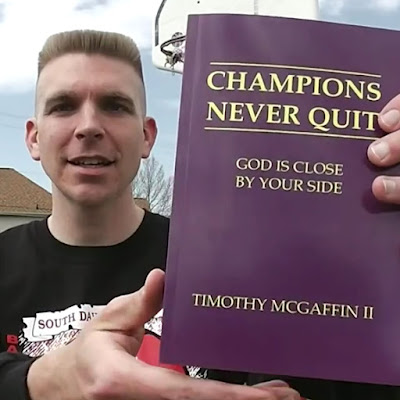 "Tim McGaffin holding ""Champions Never Quit: God Is Close By Your Side"" close up"