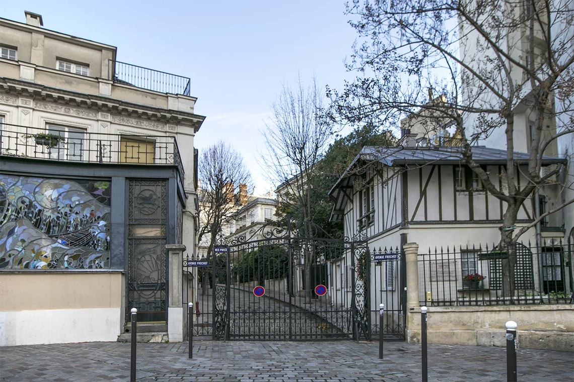 Black iron gate to private Avenue Frochot in Paris seen on Hello Lovely Studio
