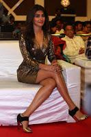 Pooja Hegde looks glamarous in deep neck sleevless short tight golden gown at Duvvada Jagannadham thank you meet function 023.JPG