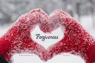 "Two hands in red gloves forming a heart-shape with ""Forgiveness"" in the heart."