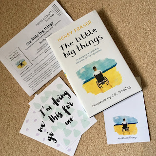 Flatlay of The Little Big Things book, press release, insert, and two quote cards, on a beige background