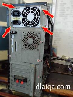 lepaskan sekrup pengunci power supply ke casing