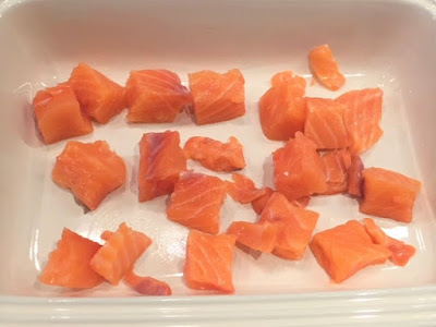raw salmon in the bottom of a casserole dish