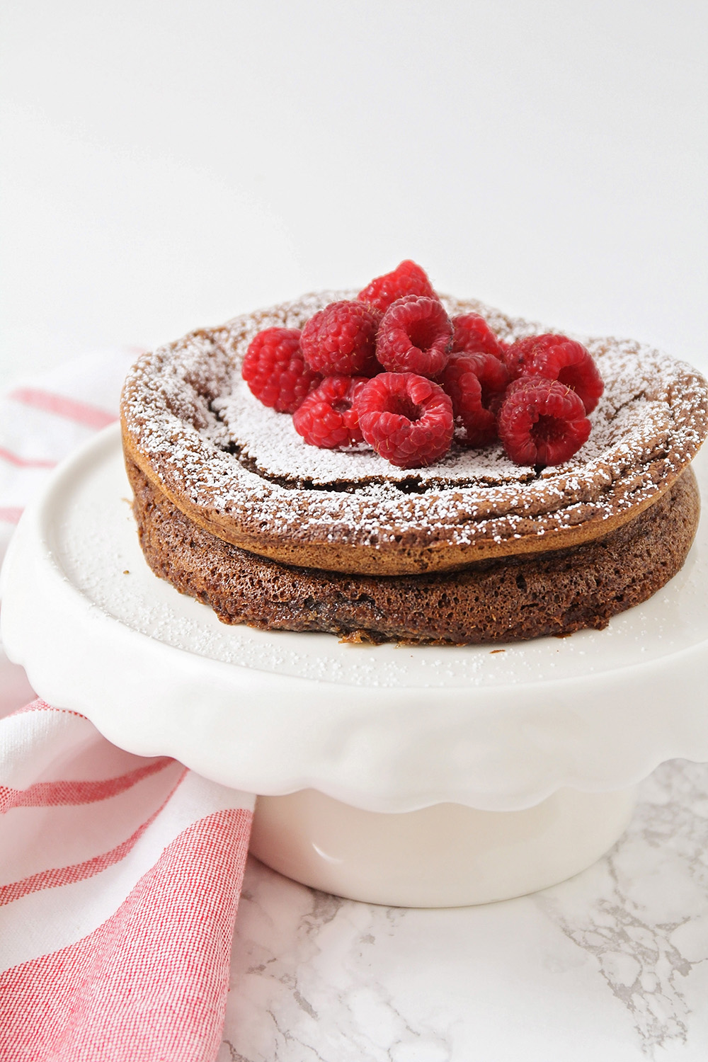 This luscious and decadent flourless chocolate cake is as simple as it is delicious!