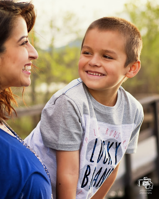a young boy's candid smile for his family portrait session