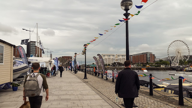 Photo of a different view of the boat show with the Wheel of Liverpool in the distance