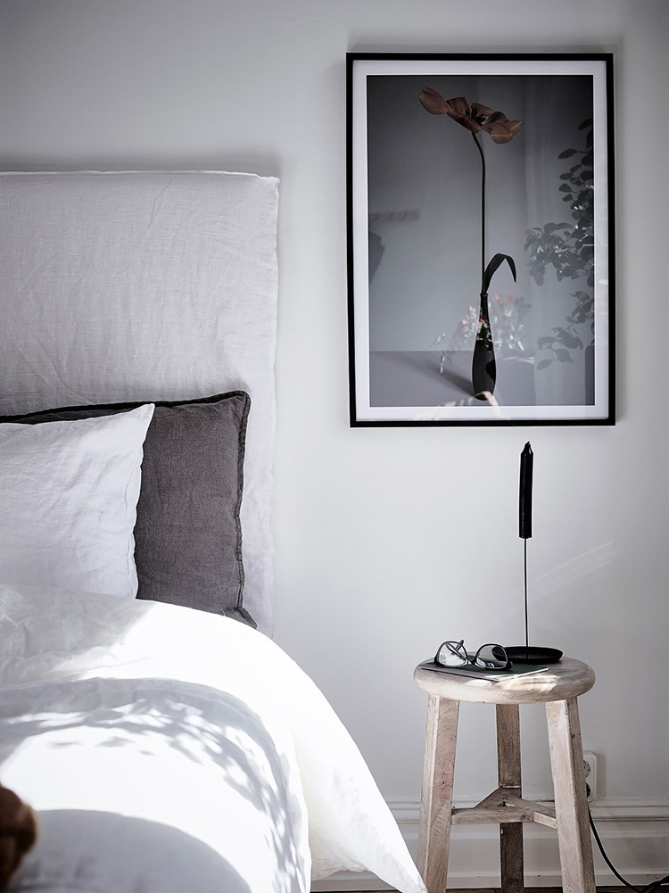 Using a small stool as a nightstand in the bedroom | Entrance