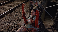 arms bursting out of the belly in baby blood (1990)