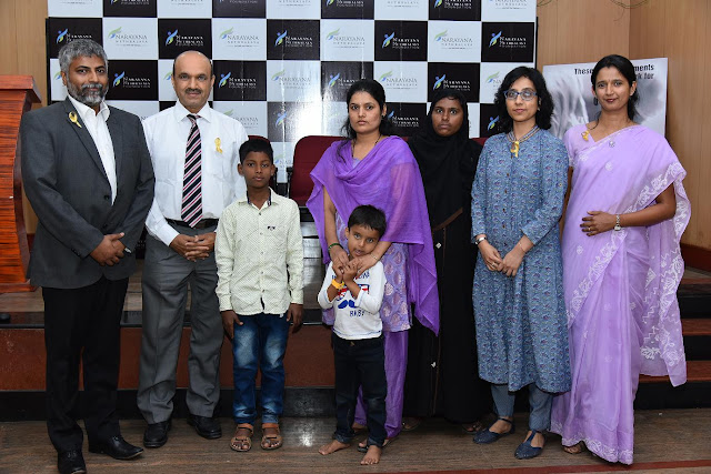 Dr. K. Bhujangashetty with parents of Cancer Survivor & Dr. Roshmi who operated on them - V1