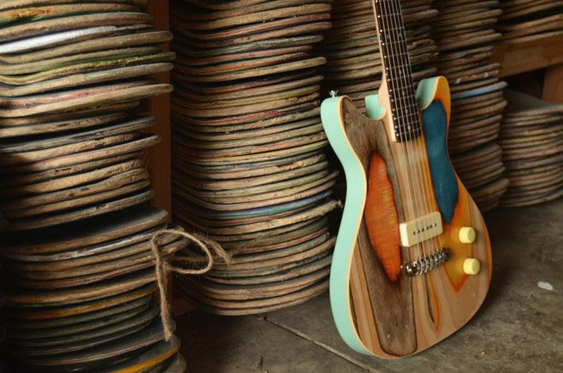 Guitarras hecho de tablas de tablas de skate usados