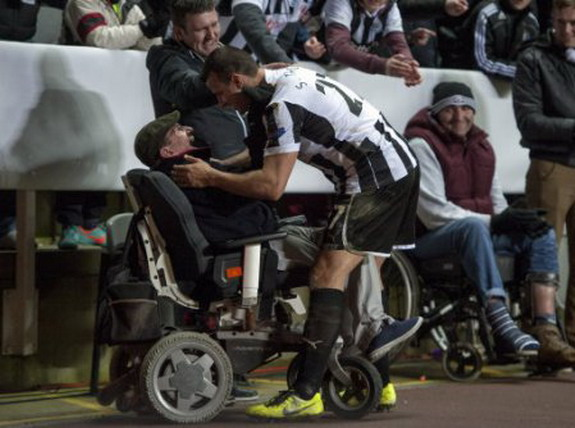 Steven Taylor hugs disabled fan after Anzhi win