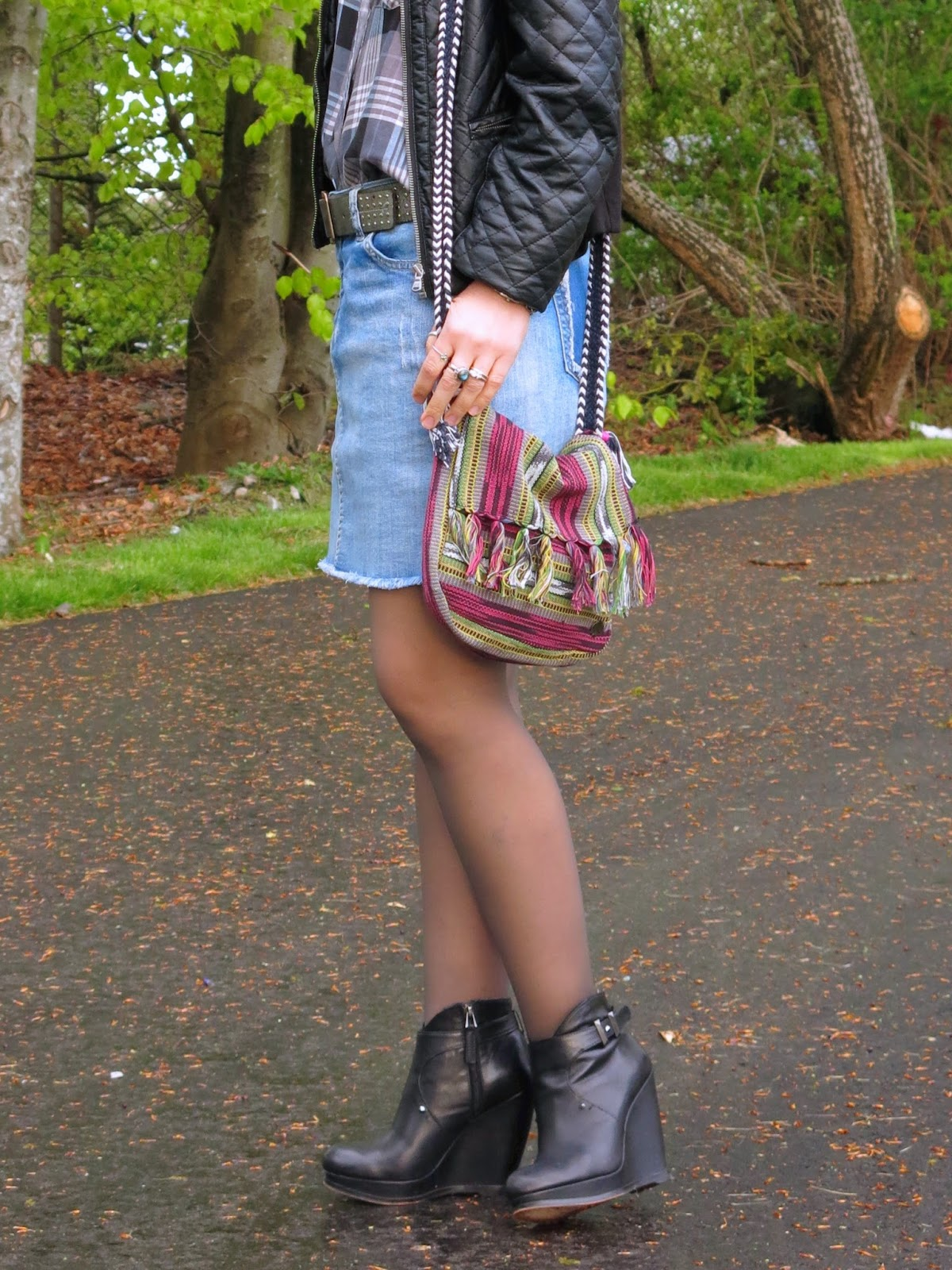 distressed denim mini-skirt, plaid shirt, quilted pleather jacket and colourful bag