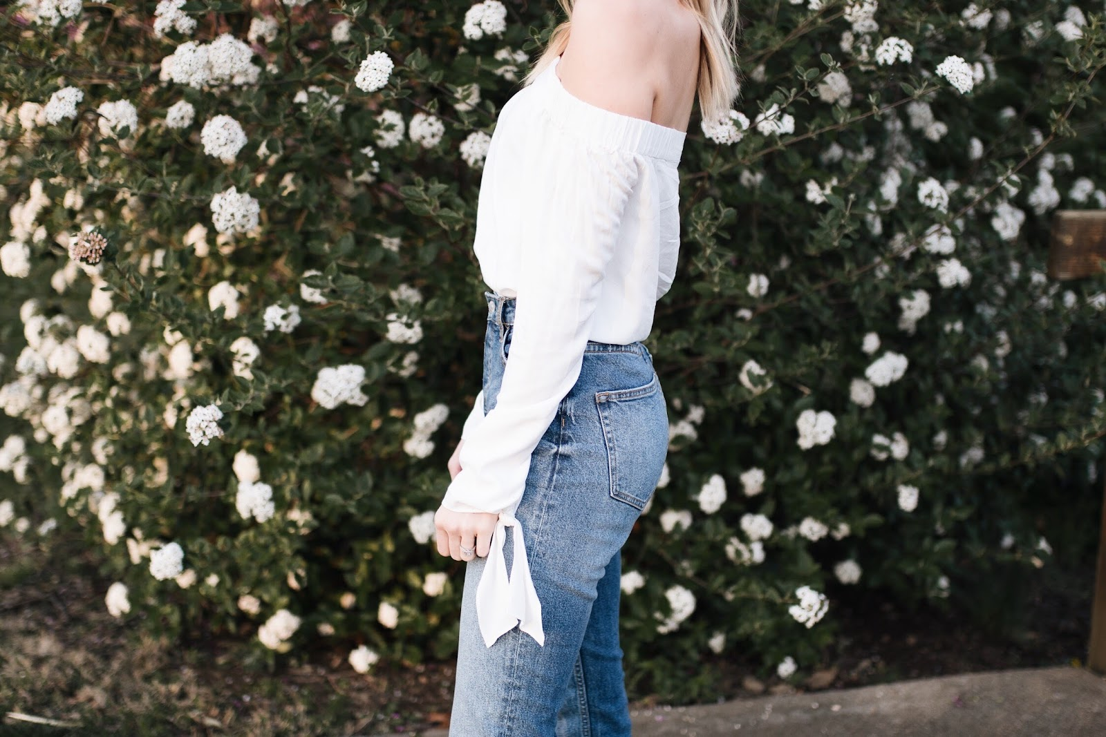 off-shoulder top + high-waisted relaxed denim