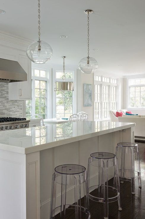 white kitchen with clear bar stools