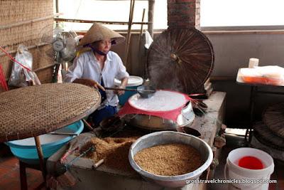 woman making rice paper