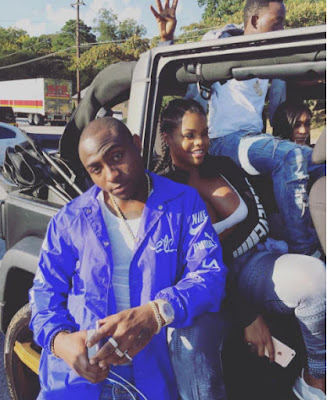 Davido releases new photos (dafuq is he wearing over his mouth?)
