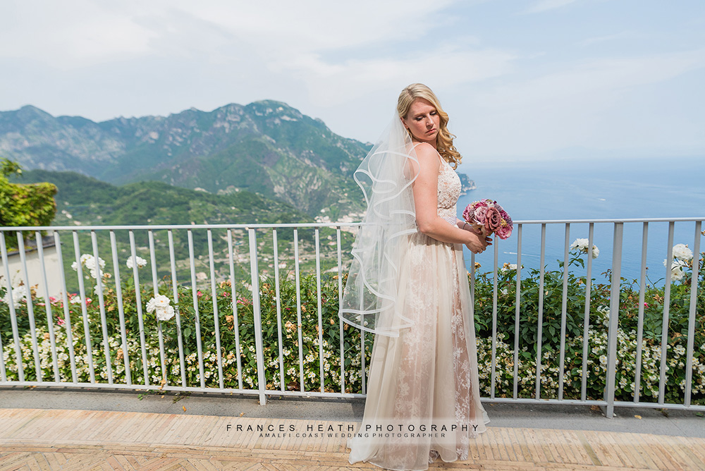 Bride infront of hotel Caruso view
