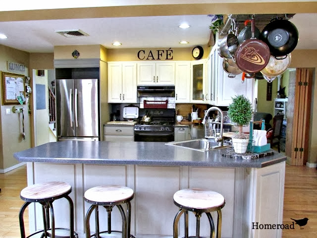 How to paint kitchen cabinets with Chalk Paint® and what we used to seal them. Homeroad.net