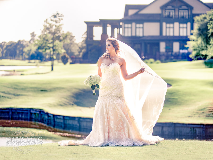 Image of a bride at the waterfall on the 18th green at River Landing Country Club - Wallace NC - River Landing Photographers
