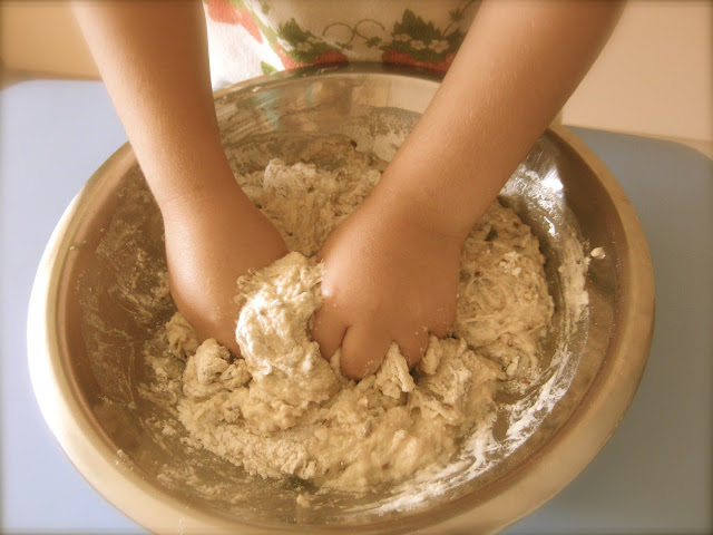 A kid making bread