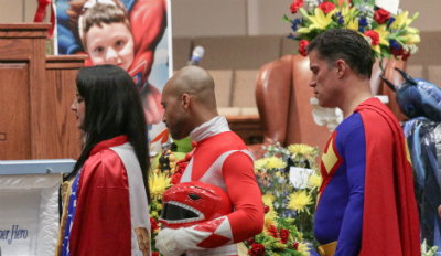 community dresses up as superheroes for boy's funeral service