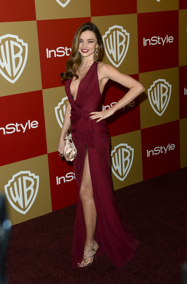 Miranda Kerr shows off a plunging neckline and a high thigh-split at the 70th Annual Golden Globe Awards
