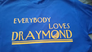 http://threadsetterz.storenvy.com/products/13321380-everybody-loves-draymond-tee-blue