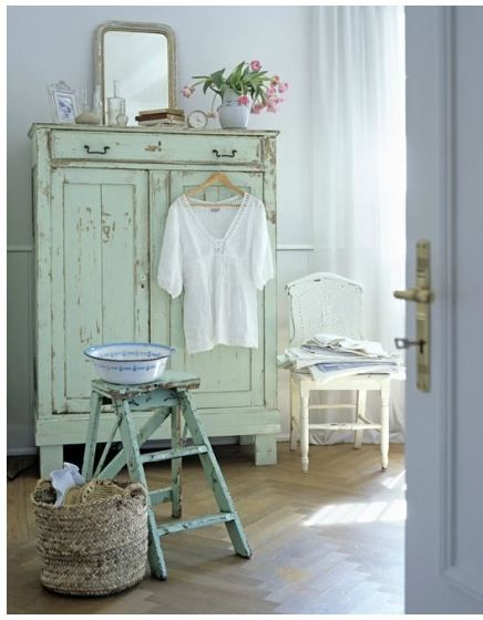 Charming light green painted Swedish antique tall cupboard - found on Hello Lovely Studio