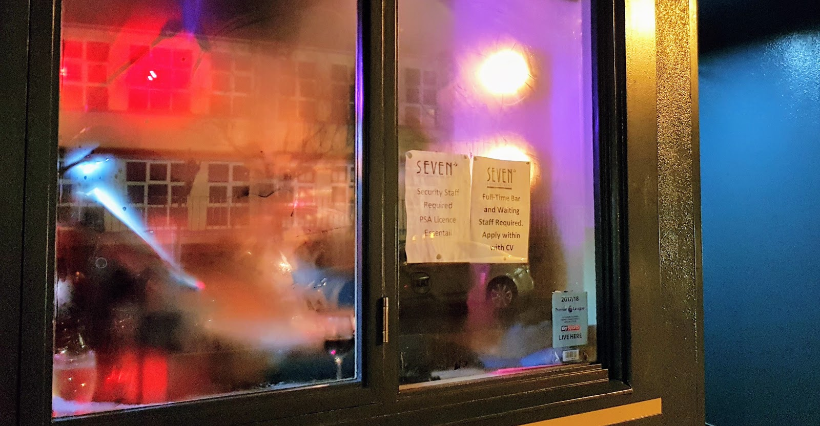 Sing in a restaurant window with blurry Monday night jazz in galway city in the background viewed through a fogged up window