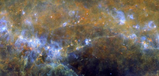 Star formation on filaments in RCW106. Credit: ESA/Herschel/PACS, SPIRE/Hi-GAL Project. Acknowledgement: UNIMAP / L. Piazzo, La Sapienza – Università di Roma; E. Schisano / G. Li Causi, IAPS/INAF, Italy