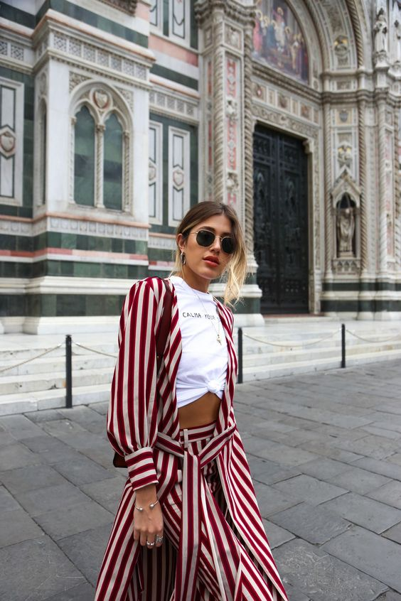 red outfit red stripe jacket and pants with hexagonal ray bans