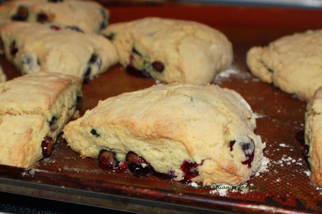 these are a delicious homemade buttery flavored baked biscuits called scones. These have blueberries in them with a drizzle of thin frosting over the top with slivered almonds. They are usually eaten at breakfast time in European pastry shops