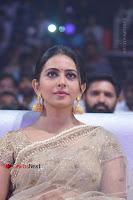 Actress Rakul Preet Singh Stills in Golden Embroidery saree at Rarandoi Veduka Chuddam Audio Launch .COM 0010.jpg