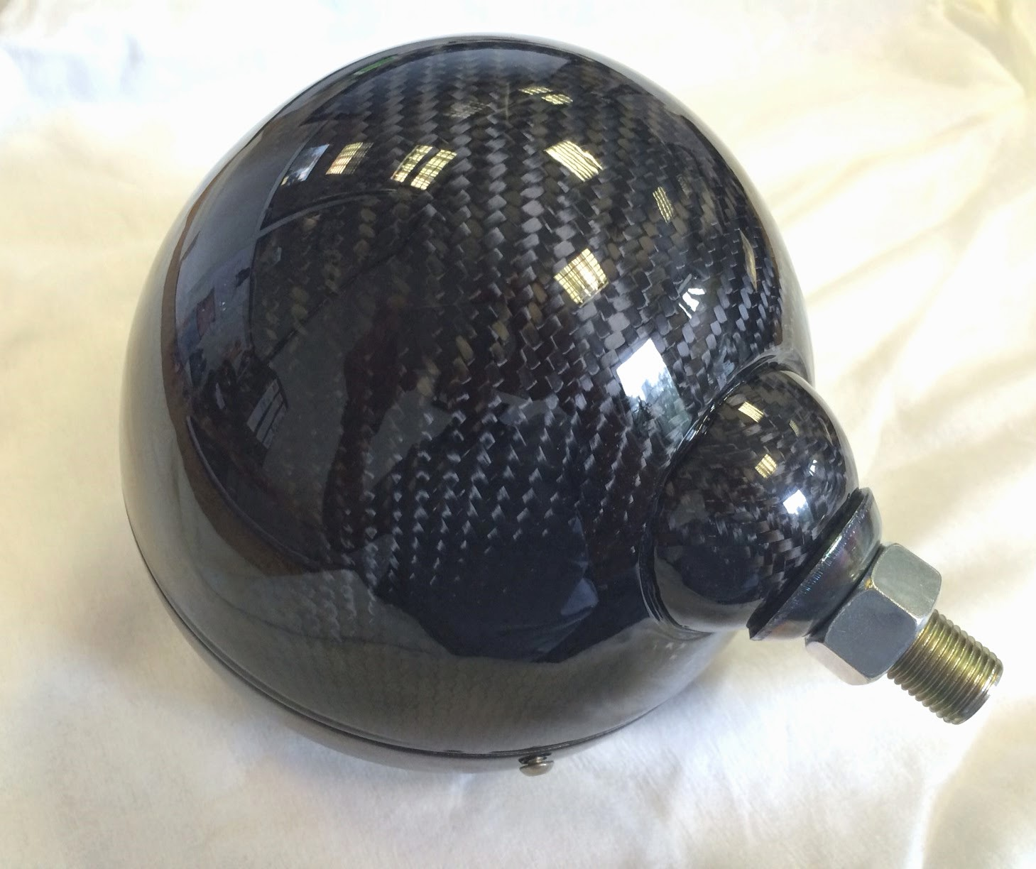 Caterham carbon fibre headlight bowls, freshly lacquered and looking amazing.