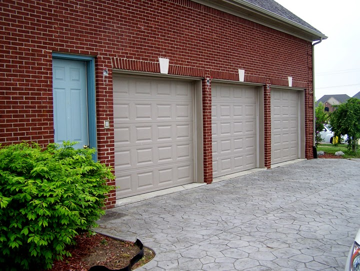 Before Faux Painting. Look At How Boring The Garage Doors Are.