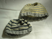Two stripey knitted hats