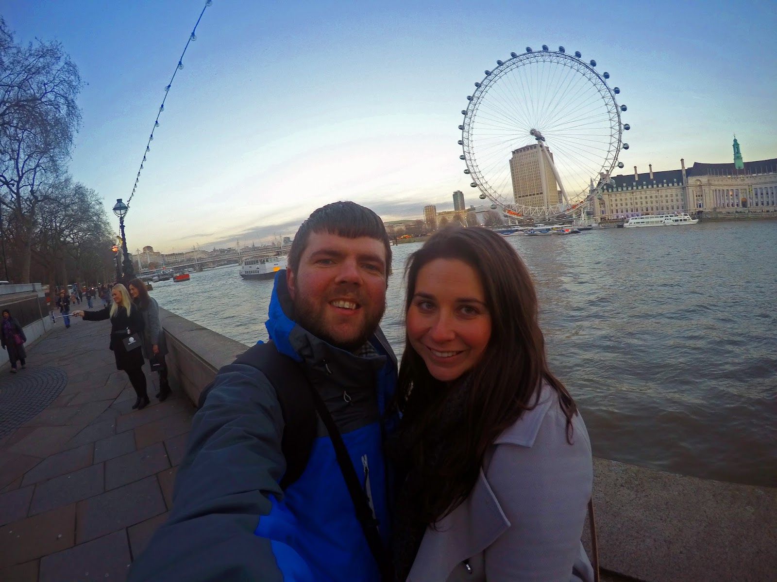 Couple in Westminster overlooking Thames and London Eye
