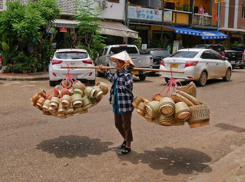 street photography woman oriental hat in Laos