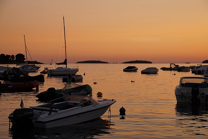 Croatia evening sky sunset boats and islands at the harbour/ seaside in summer
