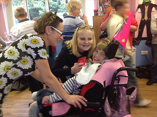 Lauren looking very happy with her Mum right next to her, and TLS staff member Natasha.