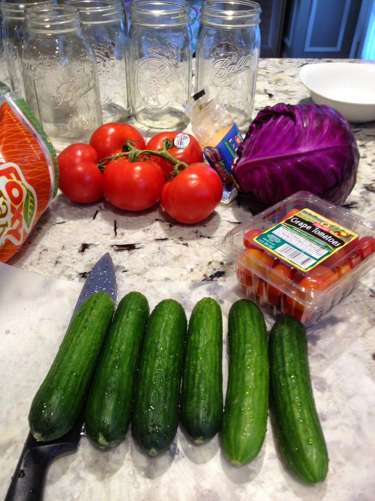cucumbers , tomatoes, and mason jars