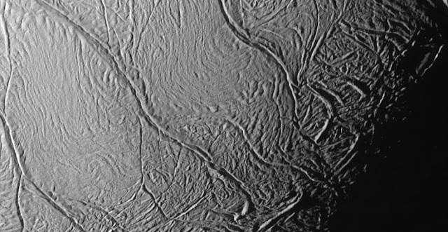 This close-up view of Saturn's moon Enceladus show a distinctive pattern of continuous, slightly curved and roughly parallel faults within the moon's southern polar latitudes. Informally called 'tiger stripes' by imaging scientists, they mark the source of the moon's long-lived geysers. Credit: NASA/JPL/Space Science Institute