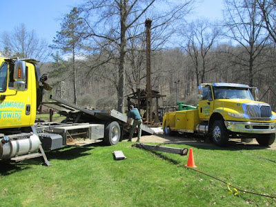 Man positions one of two tow trucks needed to move oil drilling rig