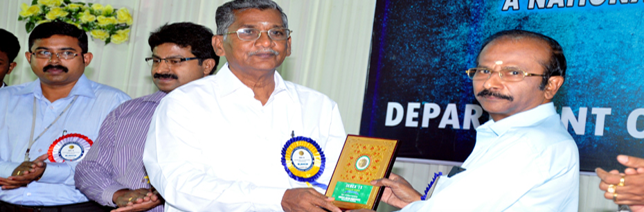 Dr. S. Manickam(Registrar-NIU) Presenting the Memento to the Chief Guest of SEBEX'15 Shri. D. Karthikesan(Director-IPRC, Mahendragiri)