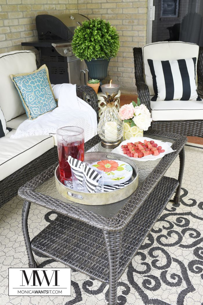The Barcelona Patio Set from Big Lots is the main attraction in this beautiful backyard patio makeover.