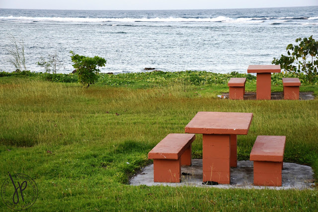 concrete picnic tables with sea view