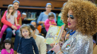 drag queen performer reads stories to white presenting children in Orlando