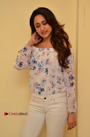 Actress Pragya Jaiswal Latest Pos in White Denim Jeans at Nakshatram Movie Teaser Launch  0062.JPG