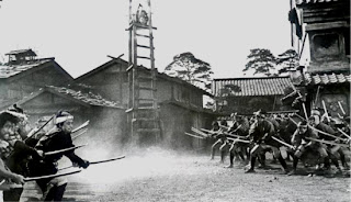the opposing gangs fight, yojimbo, directed by akira kurosawa
