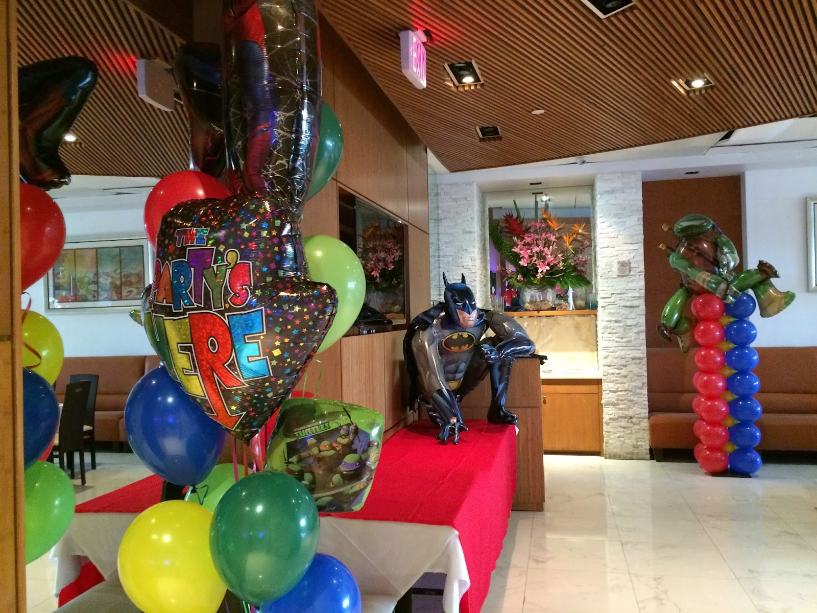 Batman, Spiderman, Ninja Turtle themed party decoration by balloons sculpture